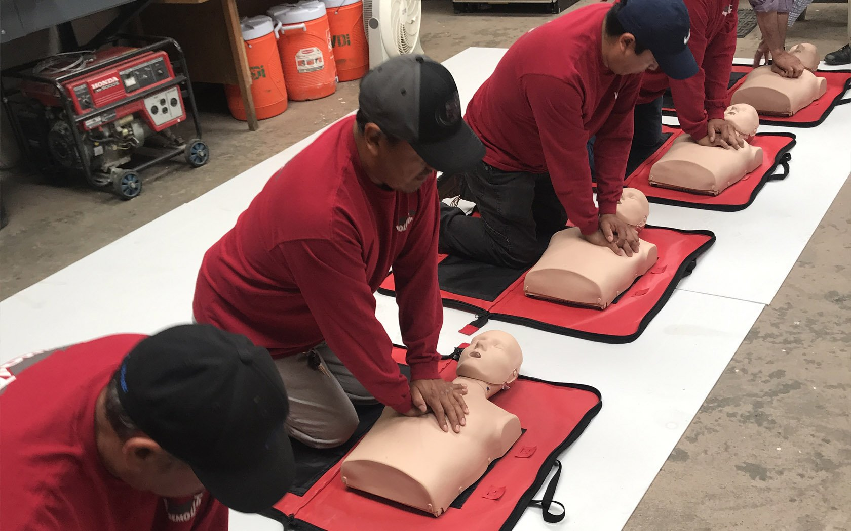 Staff at V's Demolition learning CPR techniques